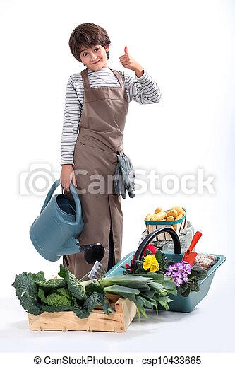 a little boy dressed in gardener - csp10433665