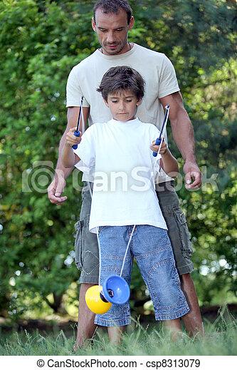 a little boy playing diabolo - csp8313079