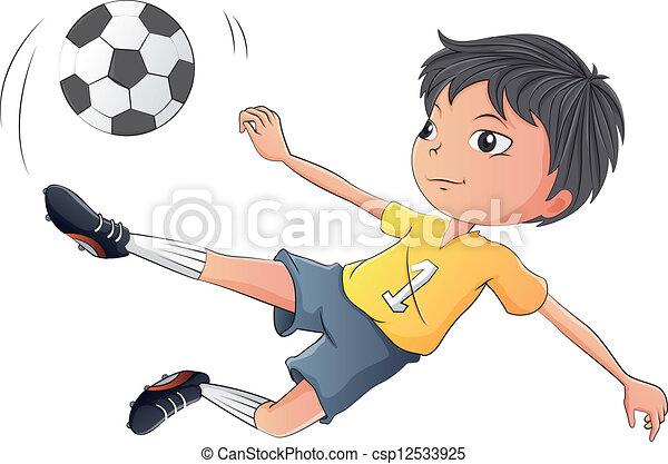 A little boy playing soccer - csp12533925
