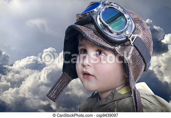 A little cute baby dreams of becoming a pilot. Pilot outfit, hat and glasses - csp9439097