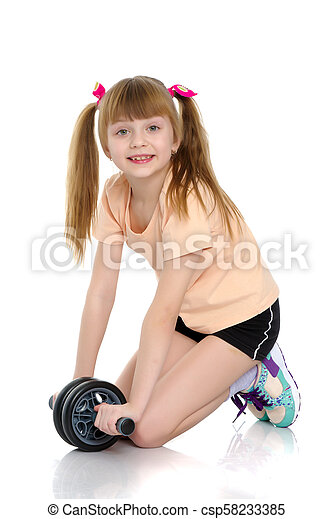 A little girl does gymnastic exercises. - csp58233385