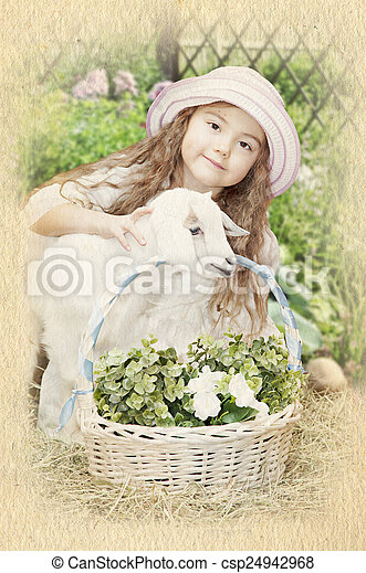 A little girl with a baby goat - csp24942968