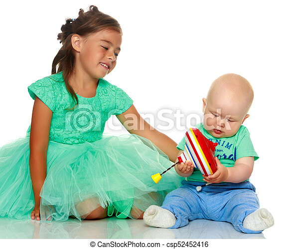 A little girl with her brother playing - csp52452416