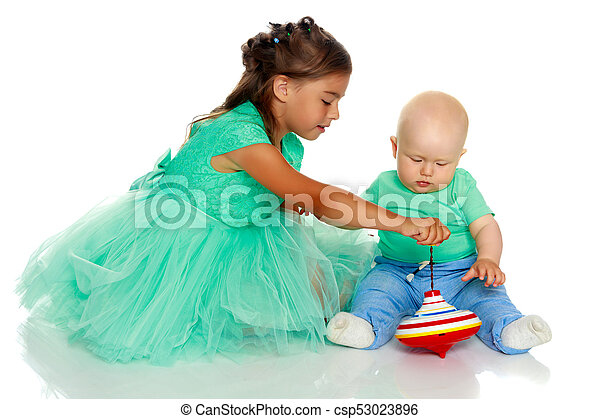 A little girl with her brother playing - csp53023896
