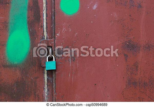 A lock on a metal rusty gate - csp50994689