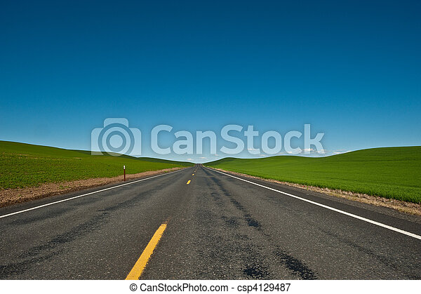 A lone and empty country road - csp4129487