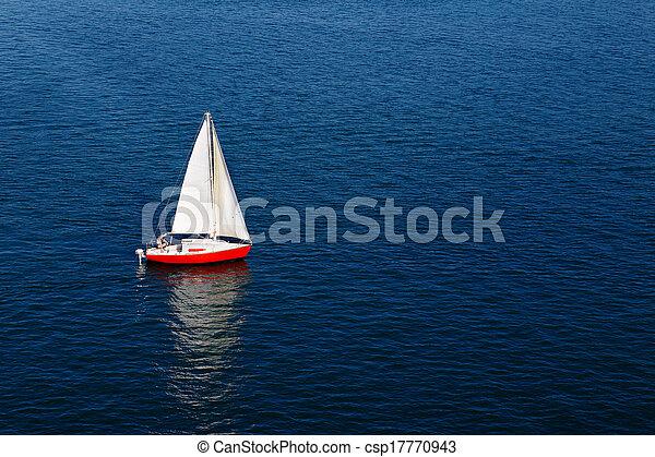 A lone white sail on a calm blue se - csp17770943
