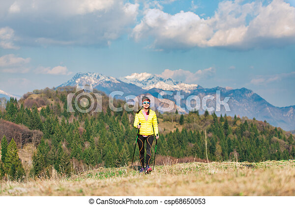 A lonely girl during a trek in the mountains in spring - csp68650053