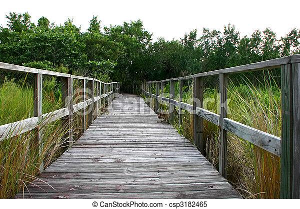 a long wooden boardwalk bridge Sanibel Florida - csp3182465