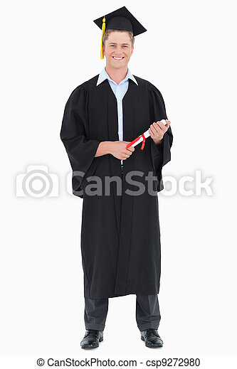 A male graduate with his degree in hand - csp9272980