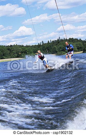 A man and woman water-skiing - csp1902132