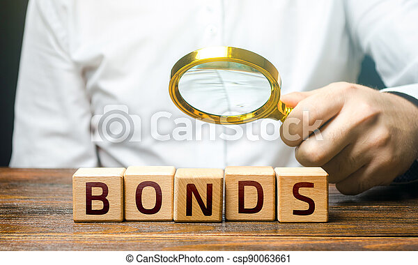 A man examines the inscription Bonds with a magnifying glass. Assessment of the value and profitability of securities. Investment. Terms and conditions. Face value. Raise money to finance new projects - csp90063661