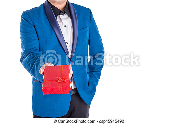 A man in suit giving red present box over white background - csp45915492