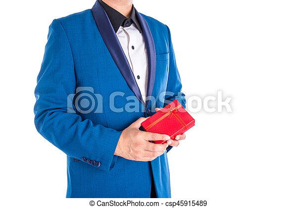 A man in suit holding red present box over white background - csp45915489