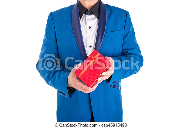 A man in suit holding red present box over white background - csp45915490