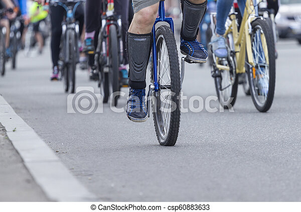 A man is riding a unicycle - csp60883633