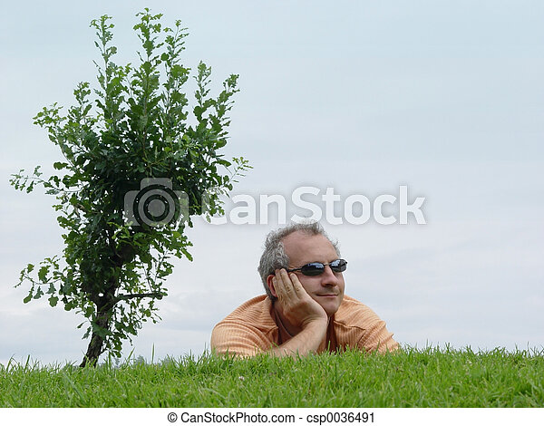 A man on the grass - csp0036491