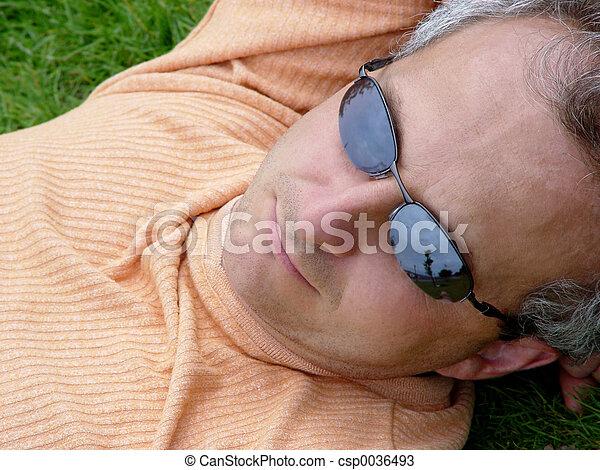 A man on the grass - csp0036493
