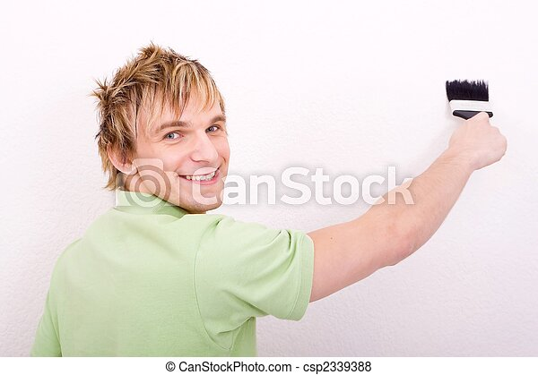 a man painting the wall - csp2339388