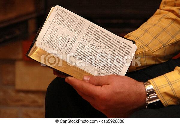 A man reads the Bible - csp5926886