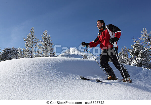 a man skiing in the snowy country - csp8825742