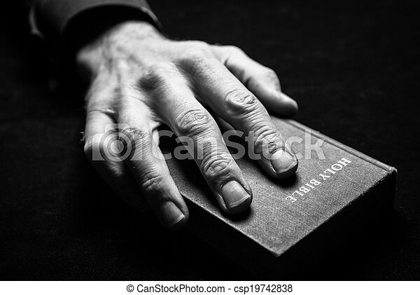 A mans hand holding the Holy Bible. - csp19742838