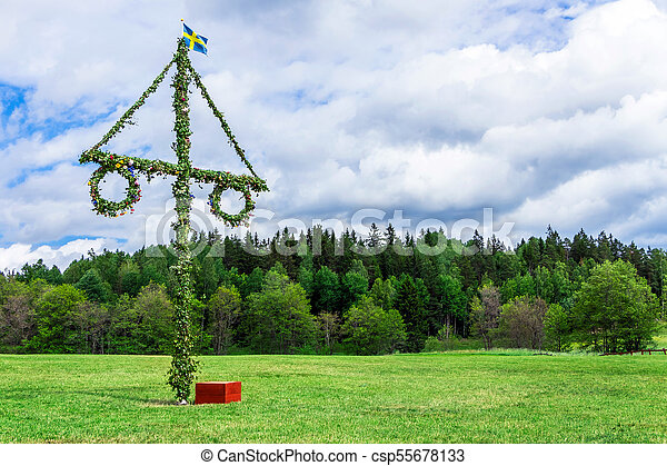 A maypole decorated with flowers. - csp55678133