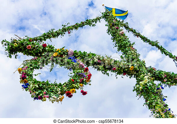 A maypole decorated with flowers. - csp55678134