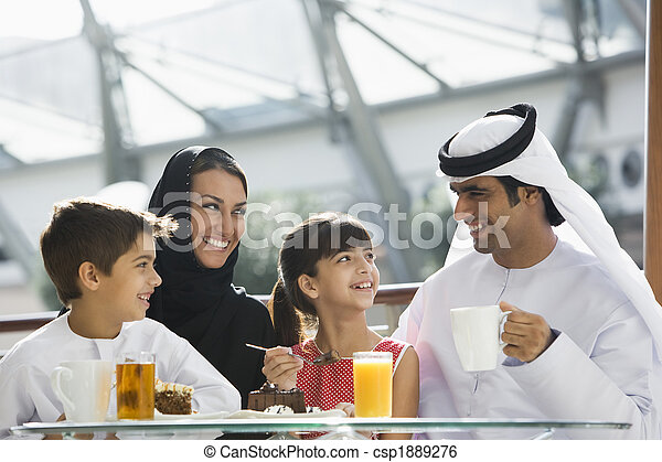 A Middle Eastern family enjoying a meal in a restaurant - csp1889276