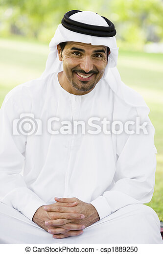 A Middle Eastern man sitting in a park - csp1889250