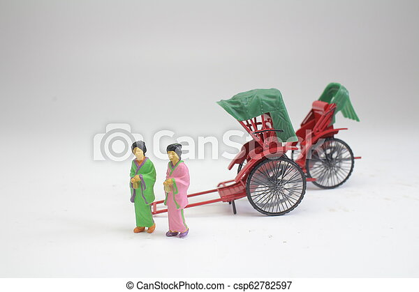 a Mini statue and red vintage oriental rickshaw cab - csp62782597