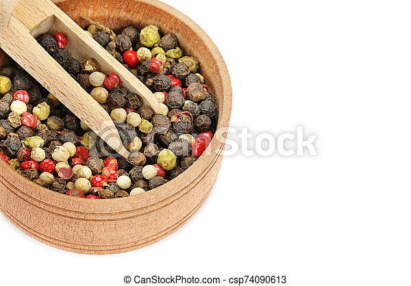 A mixture of allspice in wooden cup isolated on white background. Free space for text. - csp74090613