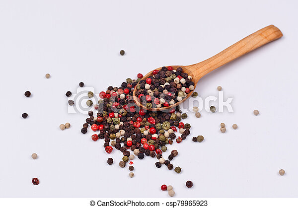 A mixture of red, black, green and white pepper - csp79965923