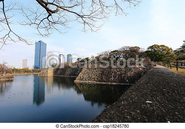 A moat surrounding Osaka castle in Japan, winter - csp18245780