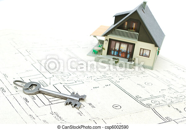A model home and house key on architectural floor plans - csp6002590