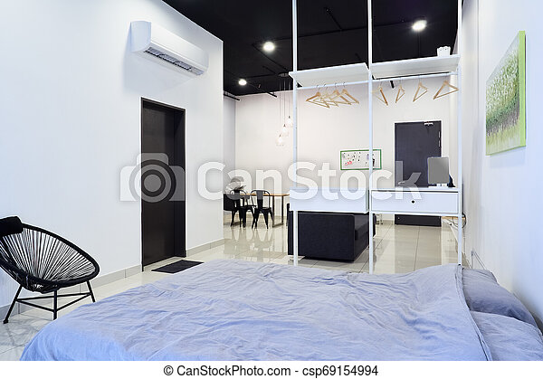 A Modern Studio Apartment Cosy And Modern Studio Apartment Bedroom In The Foreground And Living Room In The Background Canstock