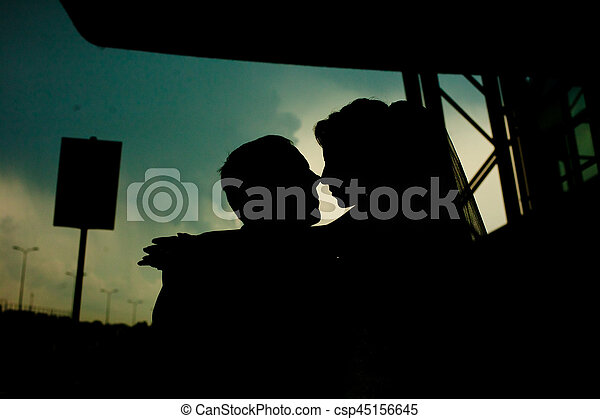 A moment before a kiss of newlyweds silhouettes - csp45156645