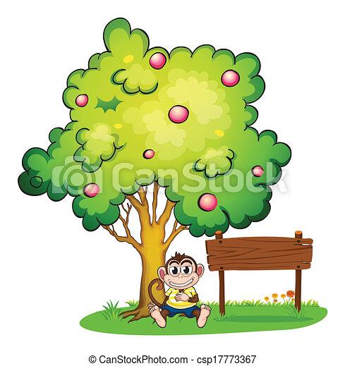 A Monkey Under The Tree Beside An Empty Wooden Signboard
