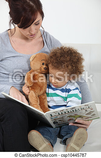 A mother reading to her son. - csp10445787