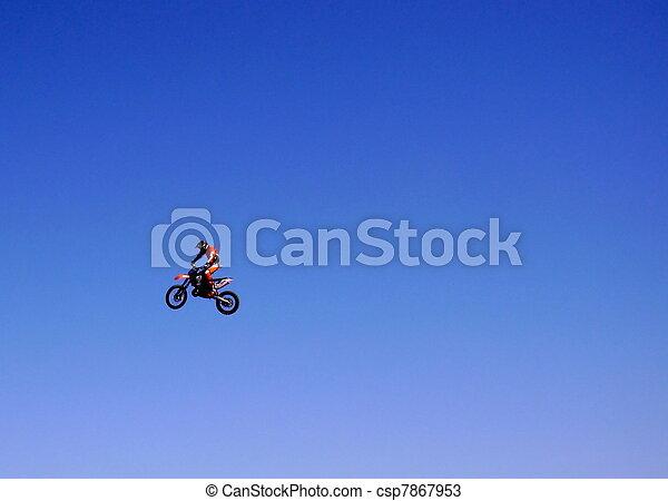 A motor bike rider in the air - csp7867953