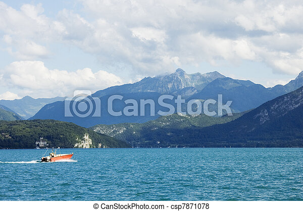 A motor boat crosses the lake Annecy - csp7871078