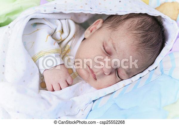 A newborn baby sleep in a crib - csp25552268