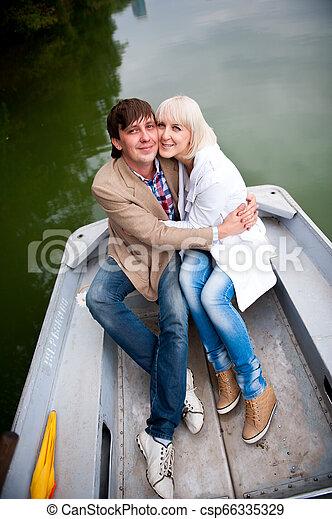 a pair of lovers on a boat in the park - csp66335329