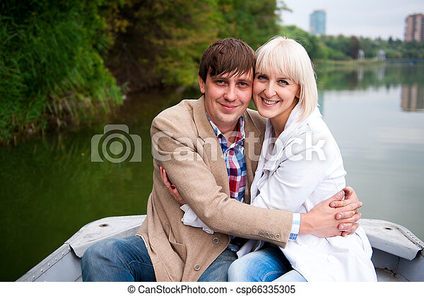 a pair of lovers on a boat in the park - csp66335305