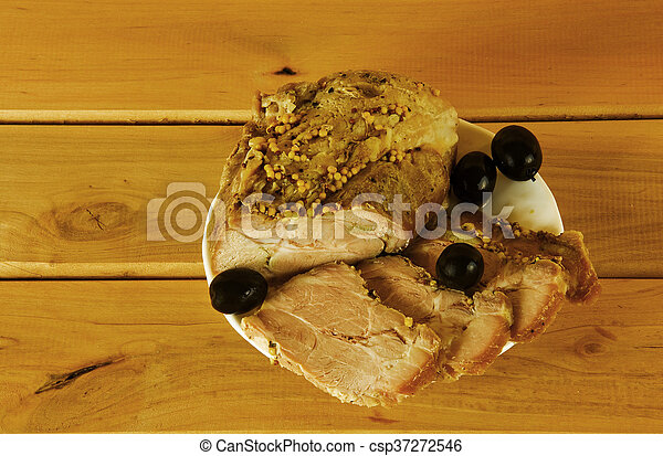 A piece of grilled meat and some olives - csp37272546