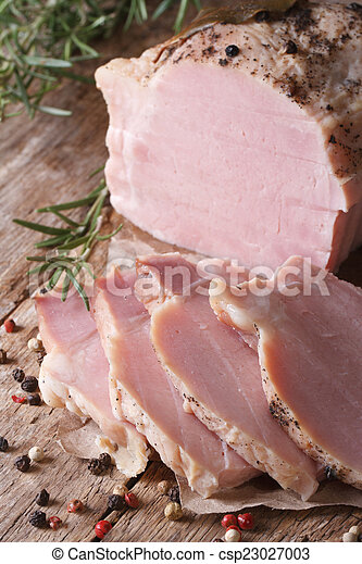 A piece of pork cooked with spices and rosemary - csp23027003