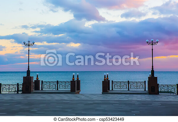 a pier by the sea with beautiful street lights - csp53423449