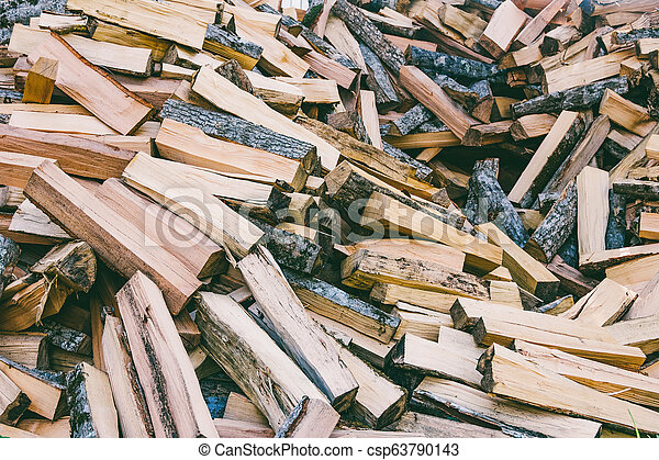 a pile of chopped wood for the stove and fireplace - csp63790143