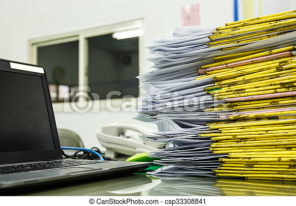 A pile of documents Desk - csp33308841