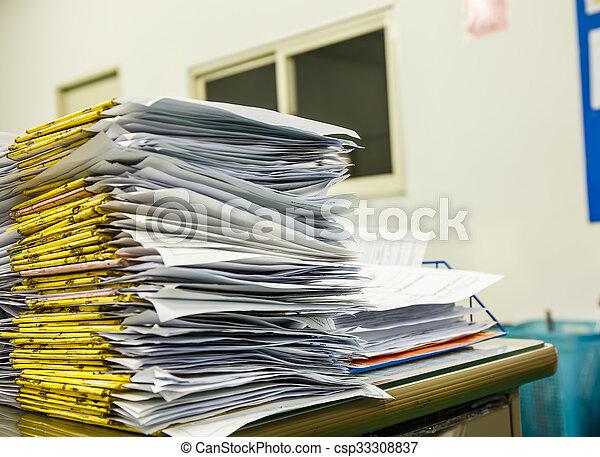 A pile of documents Desk - csp33308837